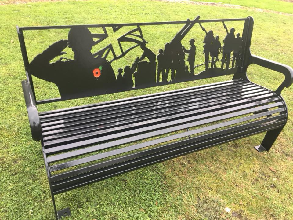 THE WAR MEMORIAL BENCH We were approached by a local committee to design and fabricate a war memorial bench for a community garden. The design was based on a collection of silhouettes of soldiers who served in both World Wars as well as modern images. The back rest was designed in house and laser cut using 8mm steel plate.