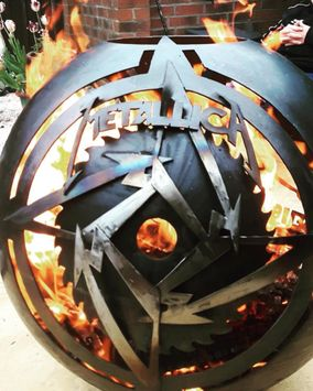 ROCK ANTHEMS GLOBE A totally personalised giant globe style wood burner which encompassed three logos....Metallica, AC/DC and the 'Three legs of Man'. Finished in an ultra-high temperature clear lacquer.
